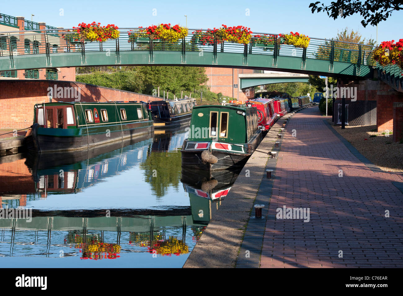 Canal boats in Banbury by the Castle Quay shopping centre . Oxfordshire, England - Stock Image