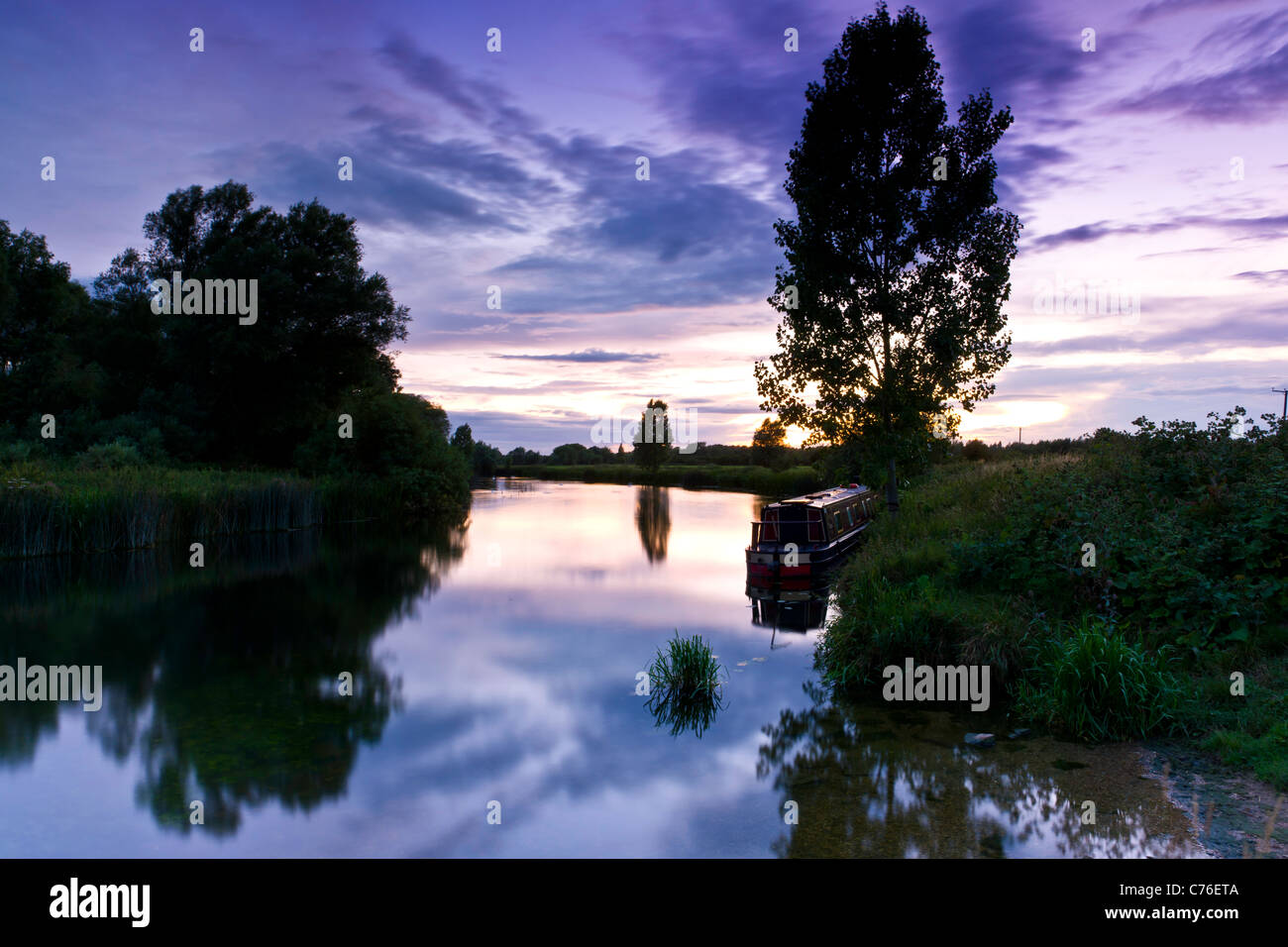 A Narrowboat on the Great Ouse at dusk - Stock Image