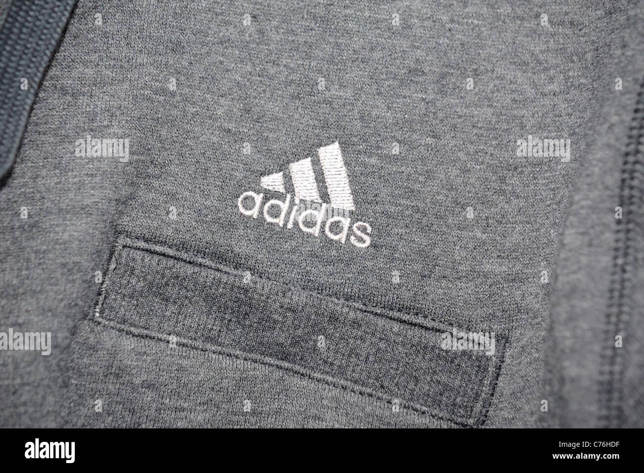 adidas logo on tracksuit top - Stock Image