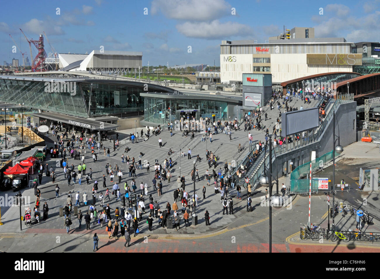View from above people in busy street scene Stratford train station & Westfield Shopping Centre with London - Stock Image