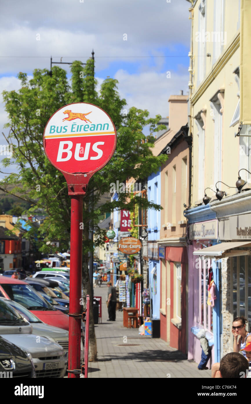 A Bus Eireann (Irish Bus Service) request stop on a street in Kenmare, Co Kerry, Ireland. - Stock Image