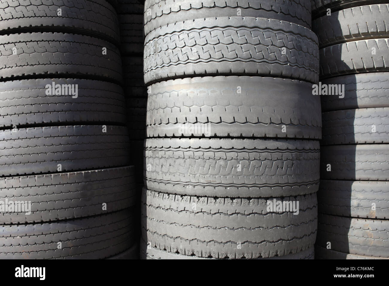 Pile Of Stacked Old Tires For Rubber Recycling Stock Photo