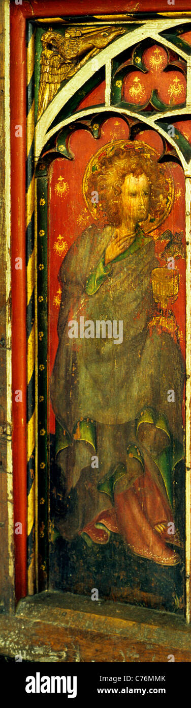 Castle Acre, Norfolk. Rood screen, St. John the Divine, 15th century. St. John holds the poisoned Chalice,  English - Stock Image