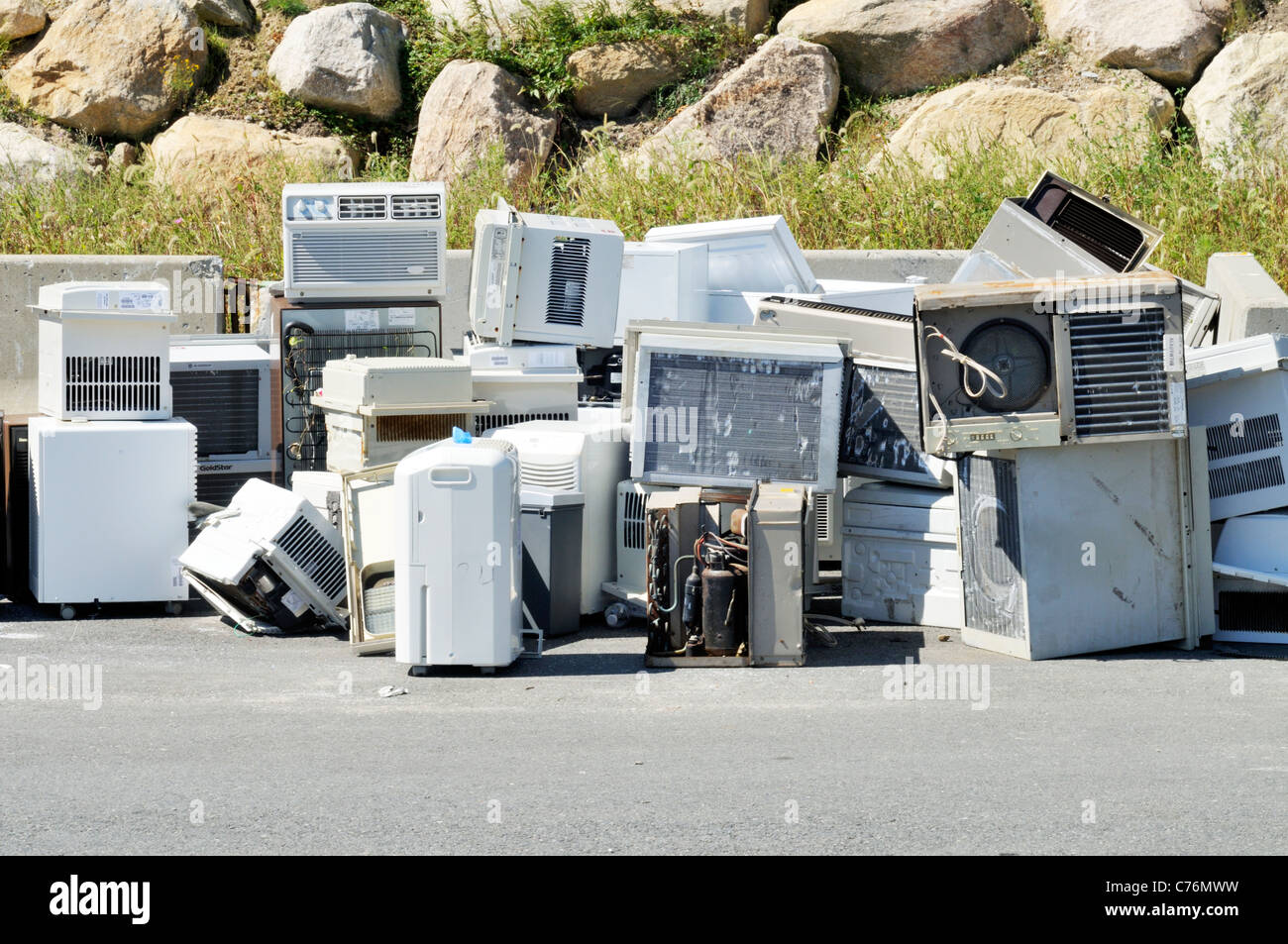 Pile of disposed or broken air conditioners at a recycling center landfill, USA. - Stock Image
