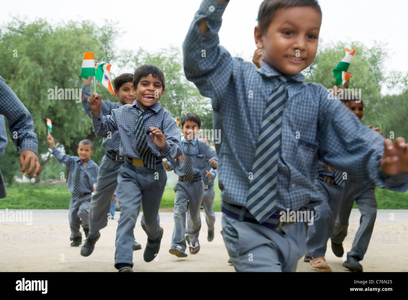 School boys running with the Indian flag - Stock Image