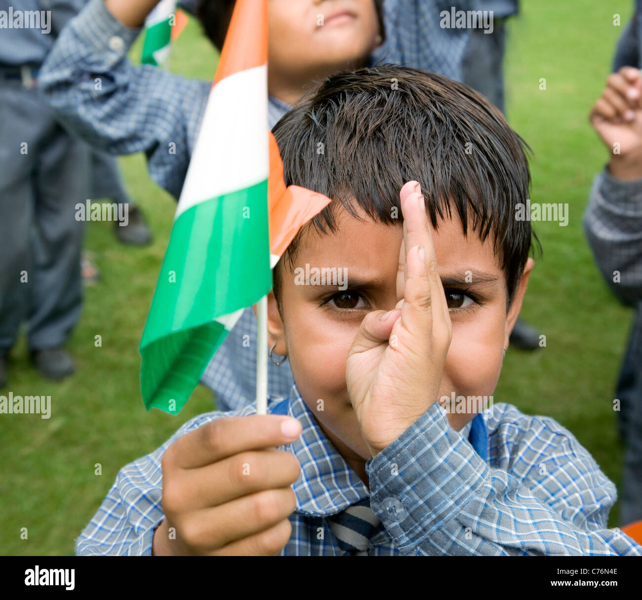 Portrait of a school girl holding the Indian flag - Stock Image