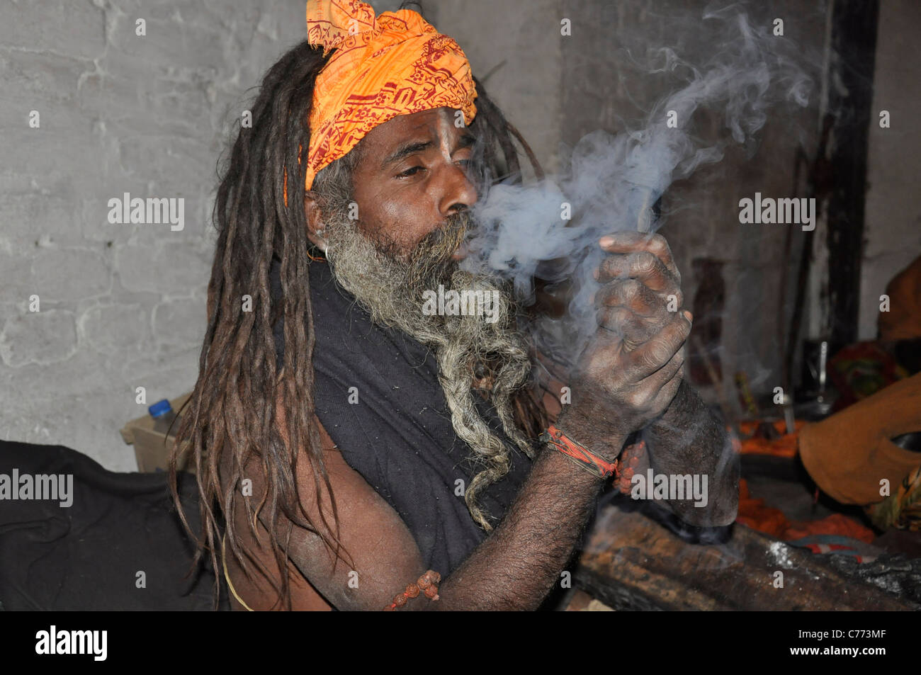 A Sadhu enjoying smoking marijuana on the occasion of  'Shiva Ratri' festival in Pashupatinath temple area, - Stock Image