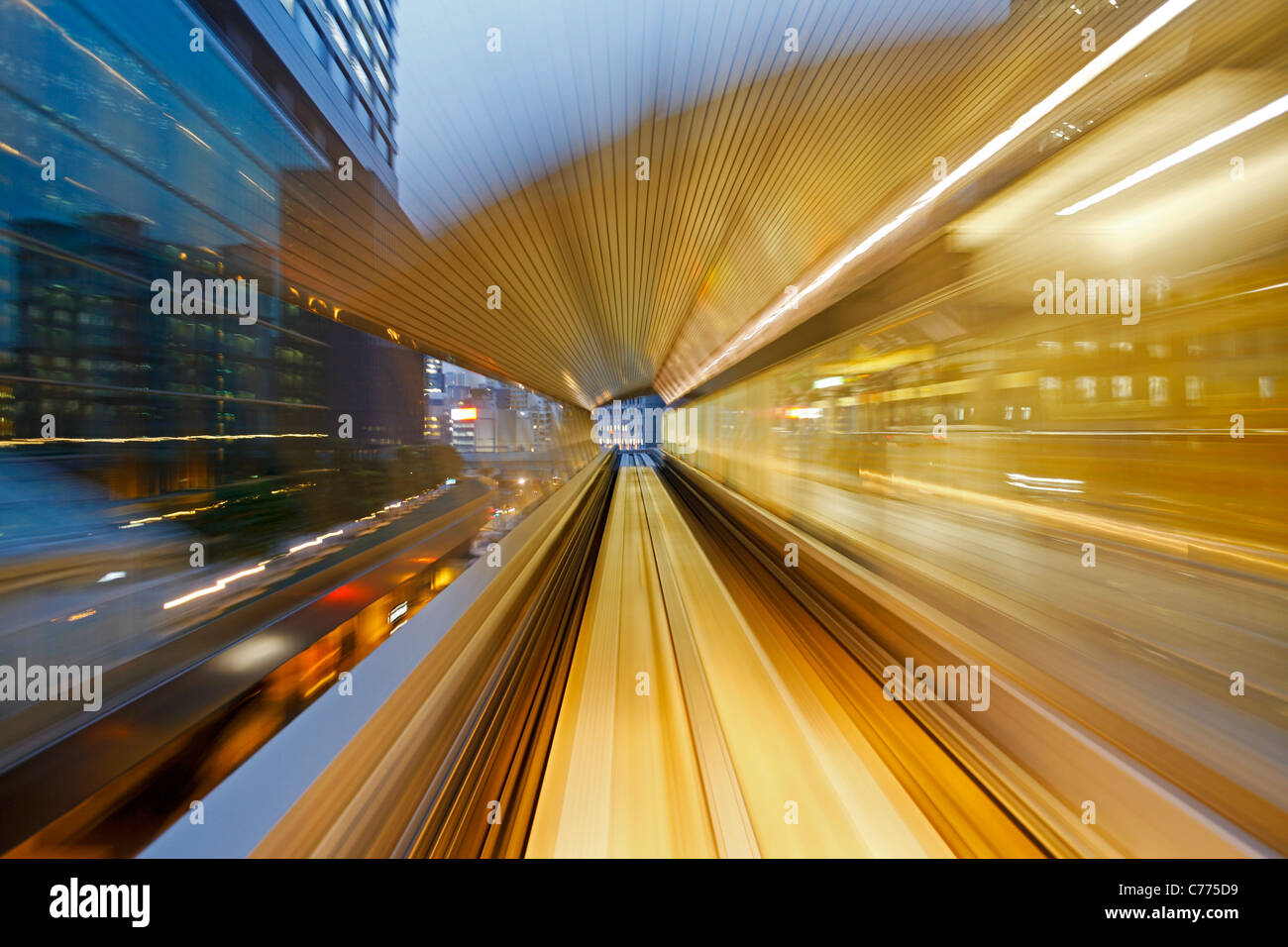 Asia, Japan, Honshu, Tokyo, POV blurred motion of Tokyo buildings from a moving train - Stock Image