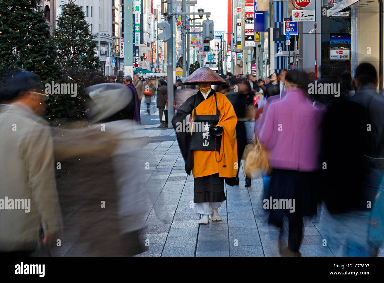 Asia, Japan, Honshu, Tokyo, Ginza, Shinto monk in traditional dress collecting Alms (donations) Stock Photo