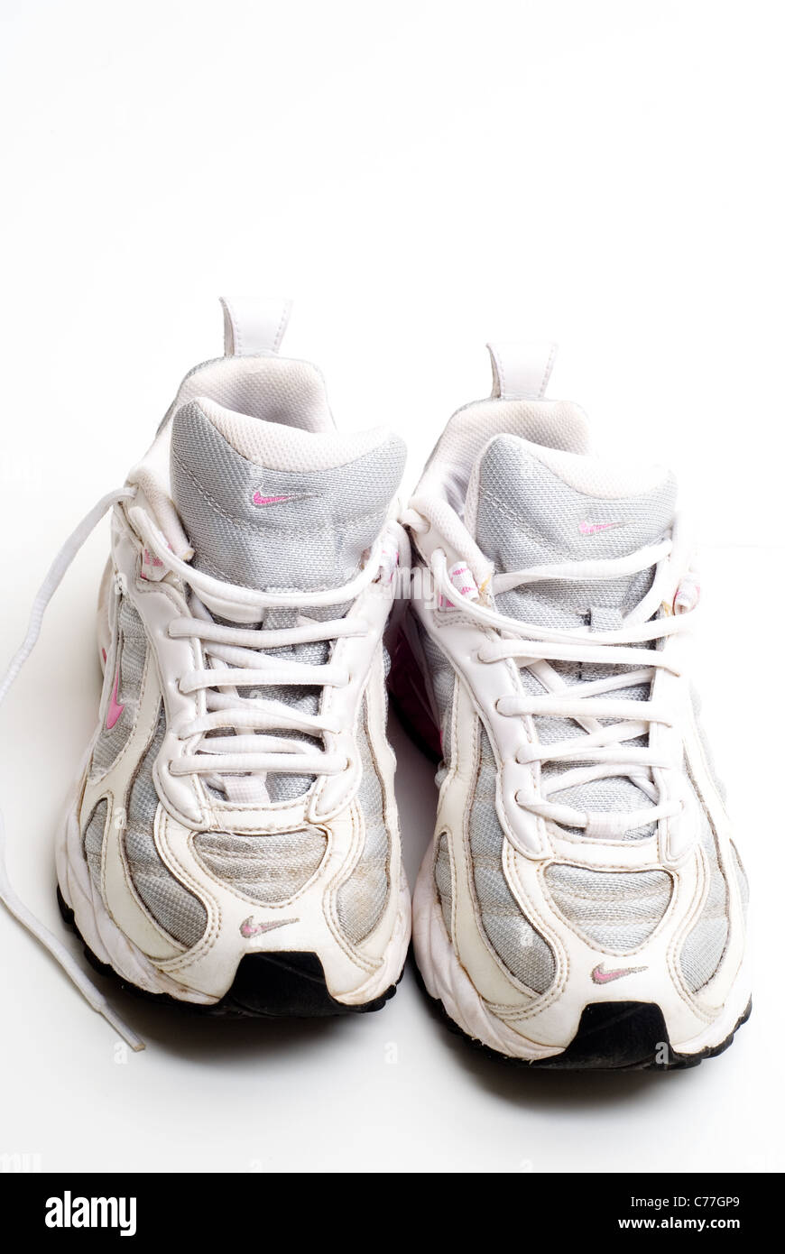 Pair of old worn Nike running Shoes. - Stock Image