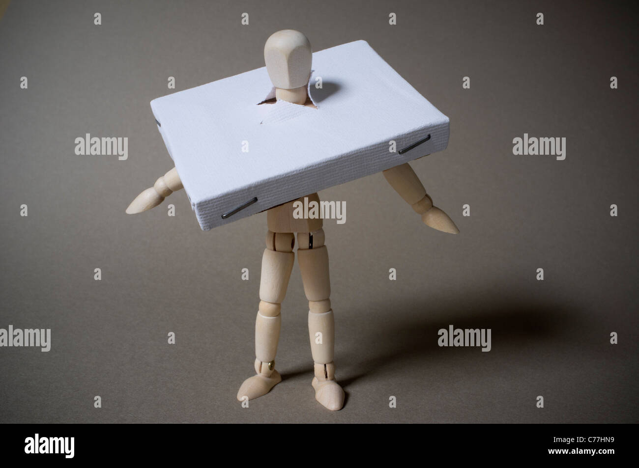 An artists canvas over a mannequins head - Stock Image