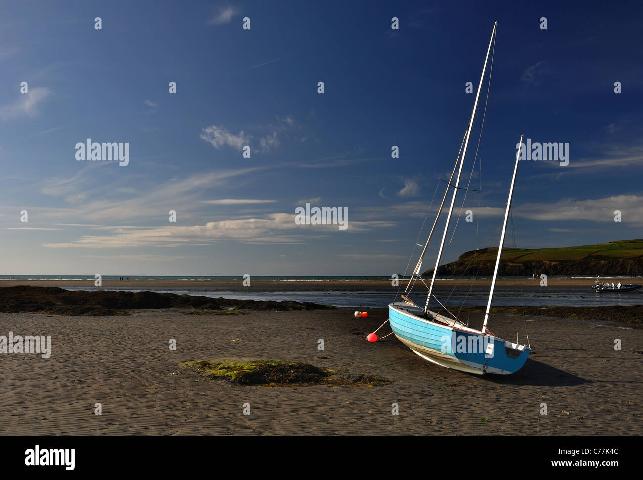Sailing yacht on drying mooring tide out Newport Parrog Pembrokeshire - Stock Image