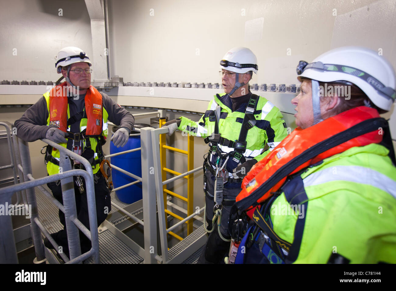 Health and safety workers inside a turbine at the Walney offshore
