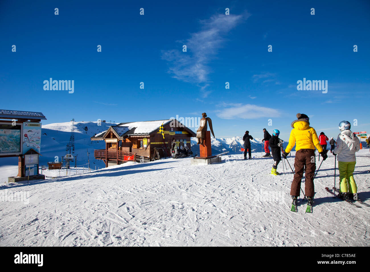Skiers on piste at Courchevel 1850, France. - Stock Image