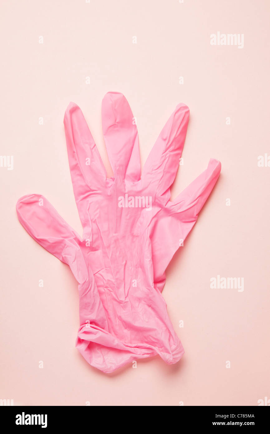 pink latex glove - Stock Image