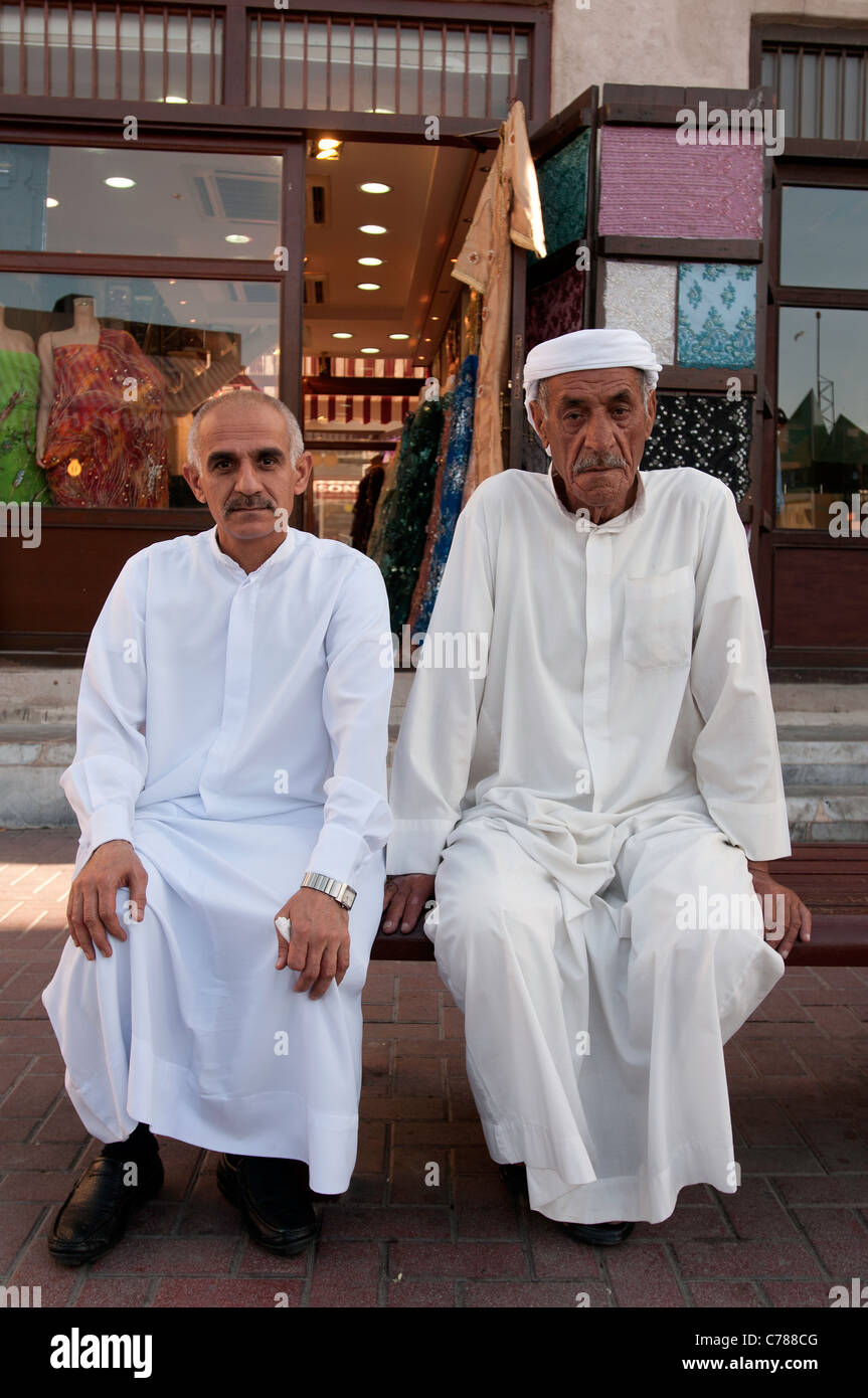 Two Arabs merchants in Dubai market - Stock Image
