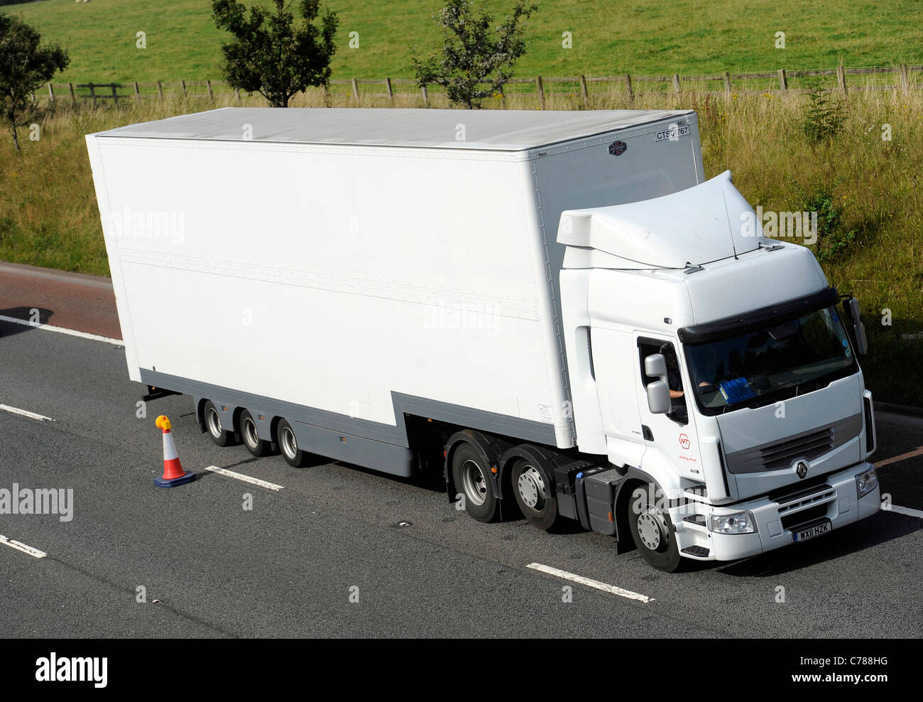 Renault Premium truck with high capacity double deck trailer - Stock Image