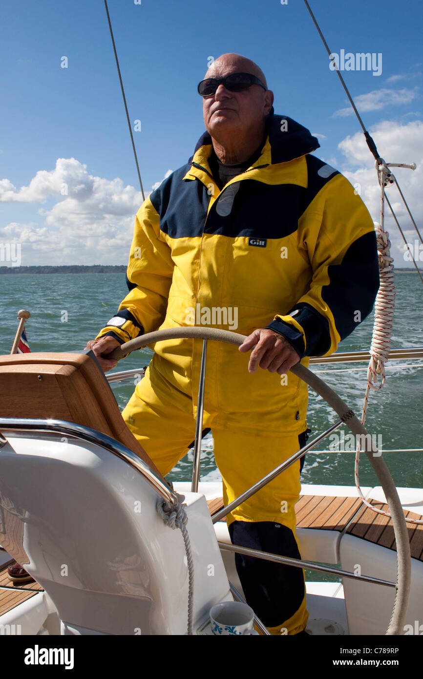 Sailer at yacht helm Stock Photo
