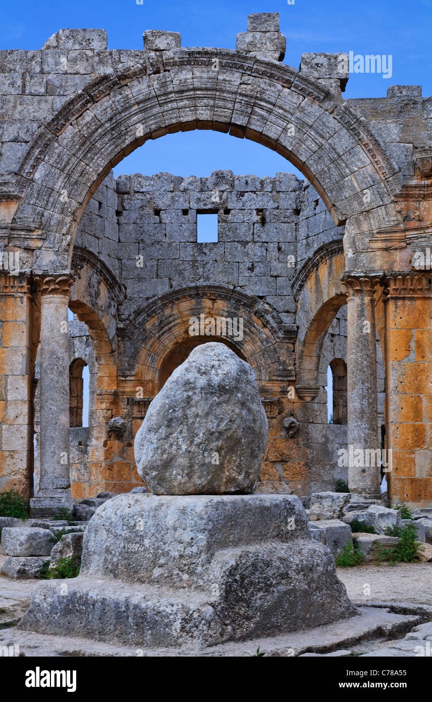 St Simeon's pillar in the ruins of the church of St Simeon, Syria - Stock Image