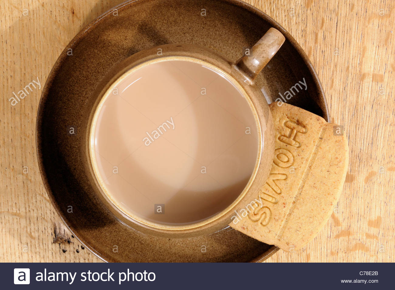 Hovis biscuit and Tea cup, England - Stock Image