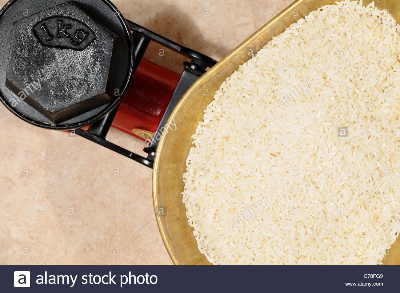 Rice grains on Kitchen scales 1kg, England Stock Photo