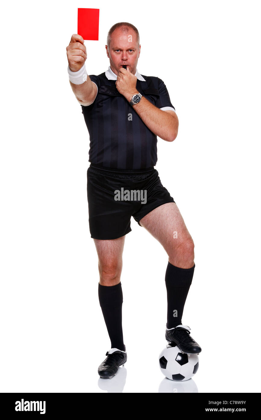Full length photo of a football or soccer referee showing you the red card for a sending off, isolated on a white - Stock Image