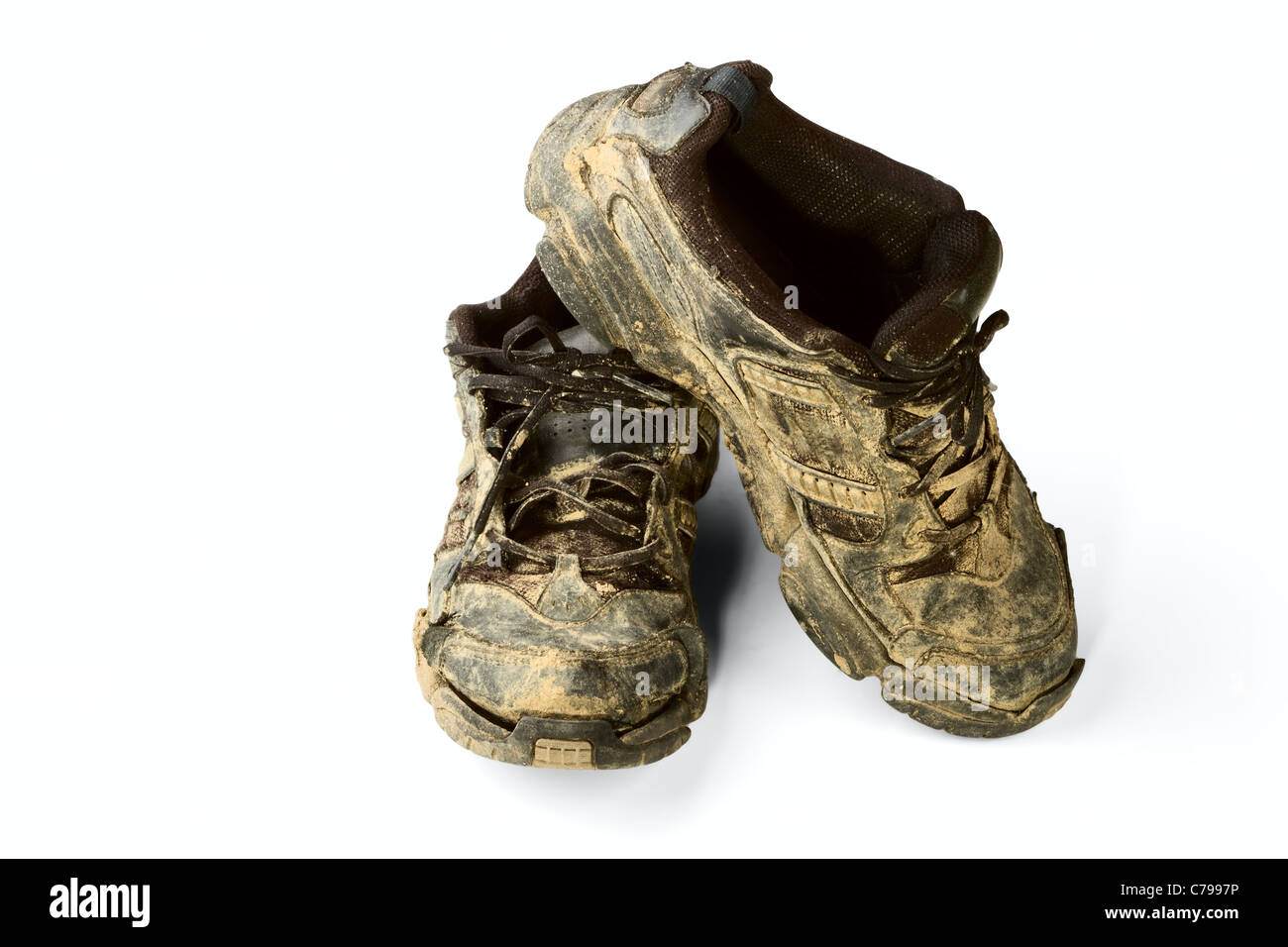 dirty trainers isolated on a white background - Stock Image