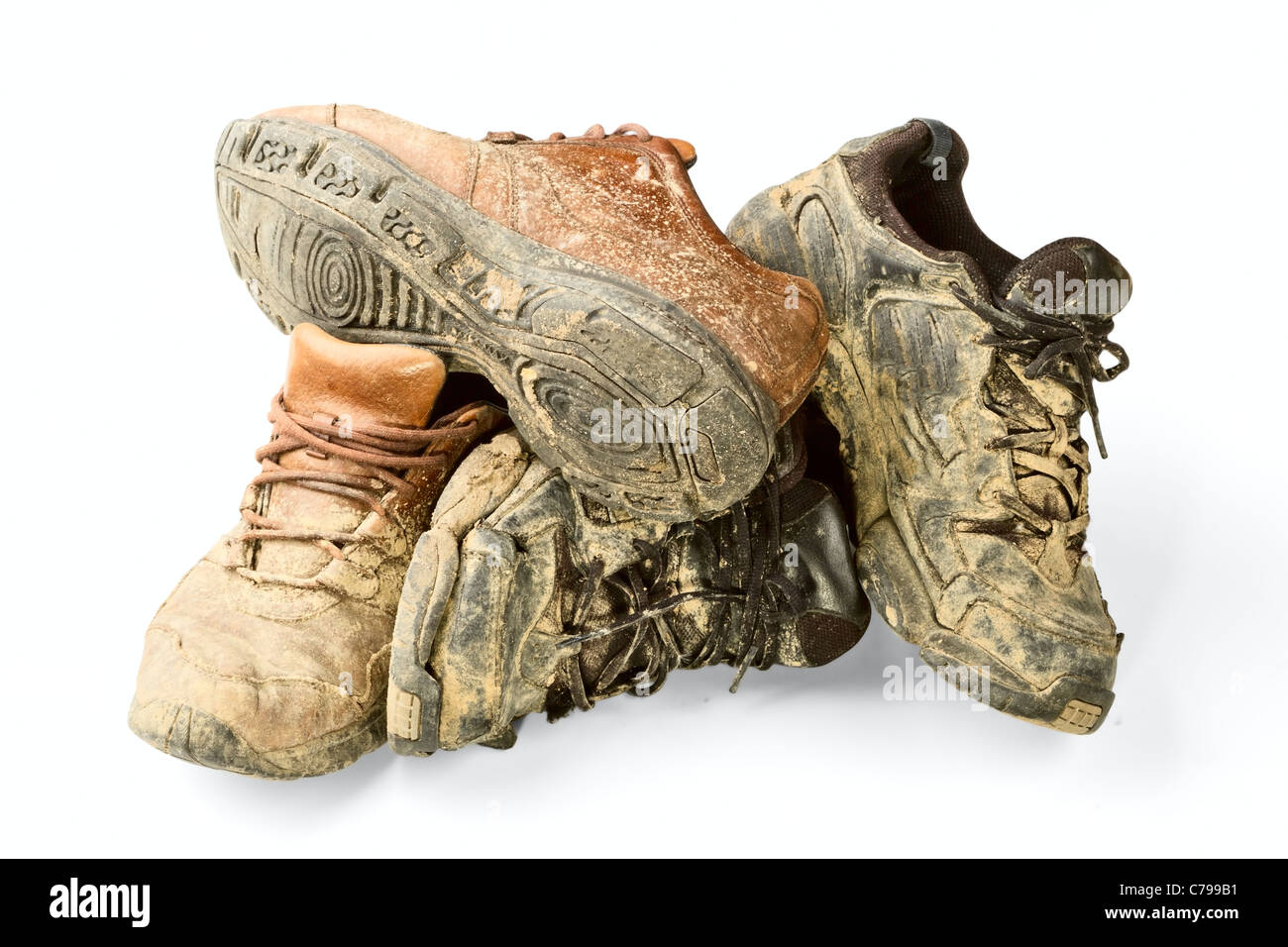 dirty trainer isolated on a white background - Stock Image