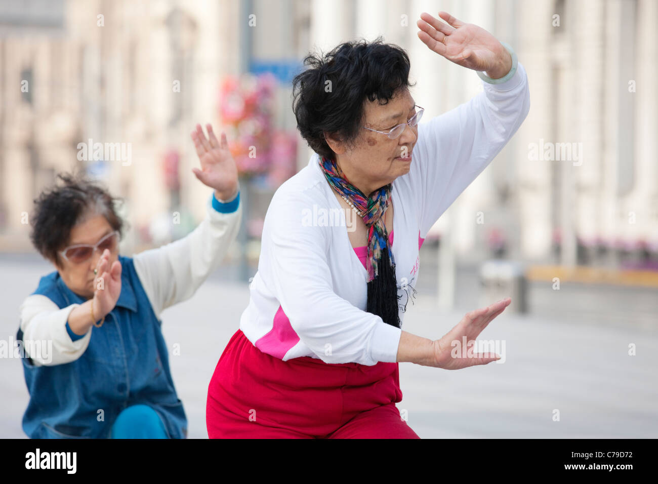 Women practicing Tai Chi, The Bund; Shanghai; China - Stock Image