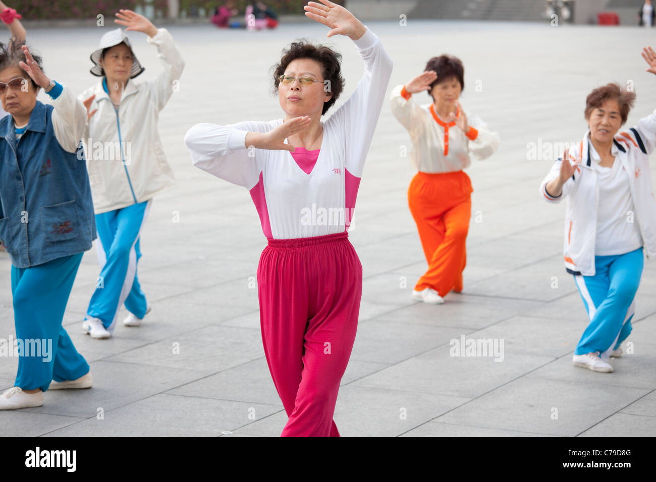 Women practising Tai Chi, The Bund; Shanghai; China - Stock Image