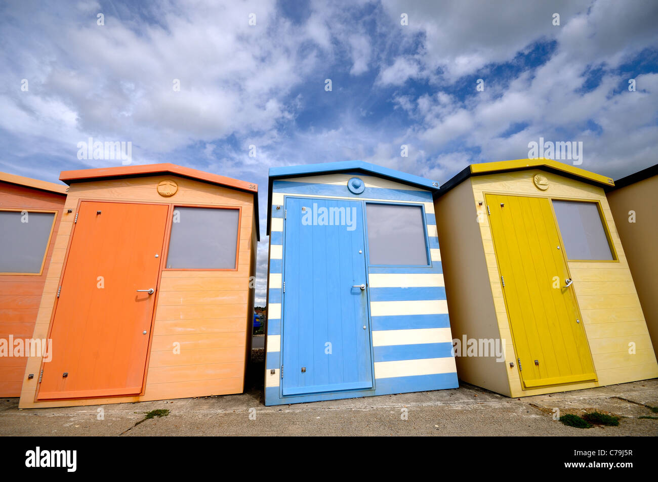 Colourful beach huts at a British seaside - Stock Image