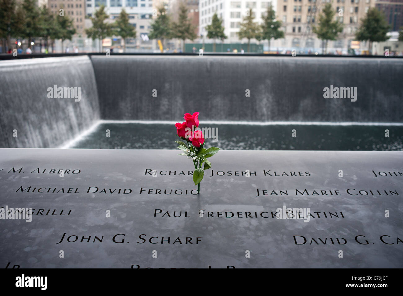 Visitors leave remembrances on names in the National 9/11 Memorial Plaza in  the World Trade Center site EDITORIAL USE ONLY Stock Photo - Alamy