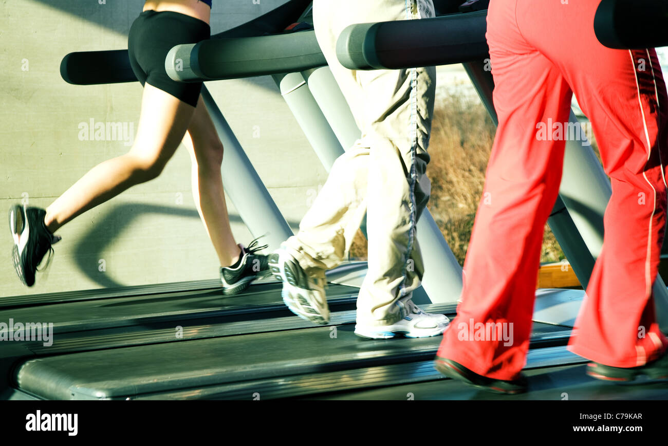 People - only legs to be seen - on the treadmill (intense colors) - Stock Image