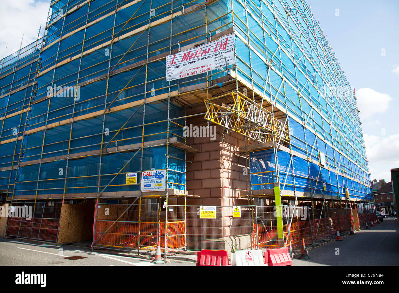 Louth, Lincolnshire, England, Town Hall covered scaffold scaffolding at the cost of 27K to council tax payer huge Stock Photo