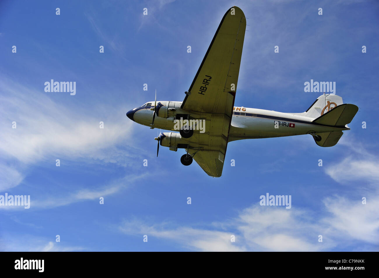 A vintage Douglas DC-3A coming in to land at an airfield Stock Photo