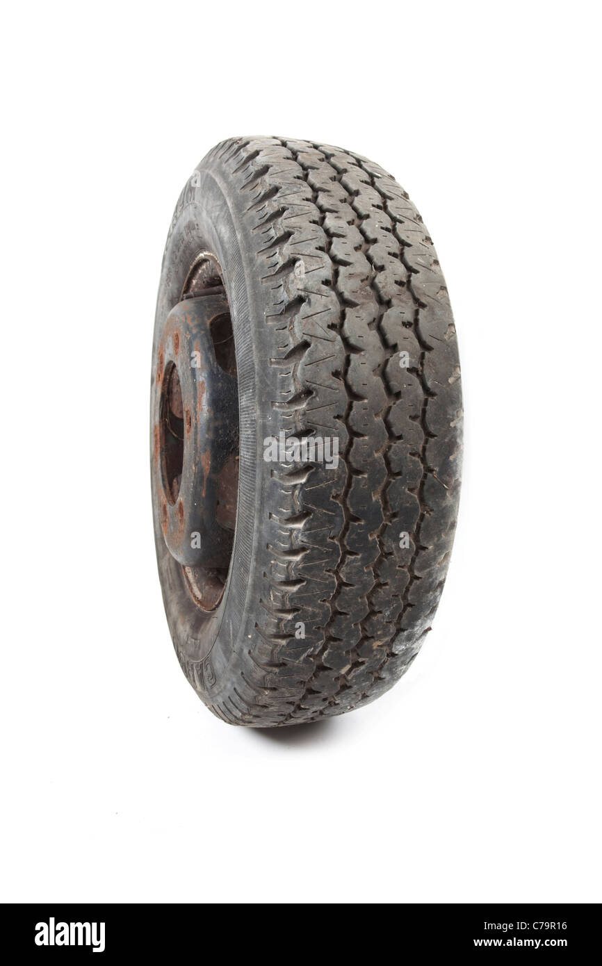 old vehicle tyre on isolated white background - Stock Image