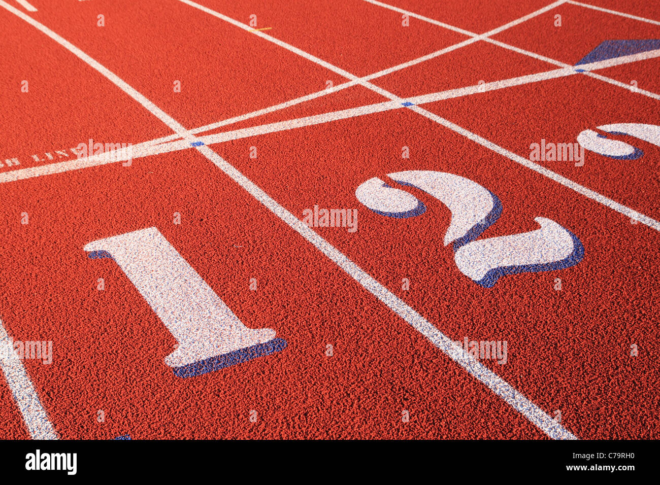 lanes one and two marked on a red rubber athletic track - Stock Image