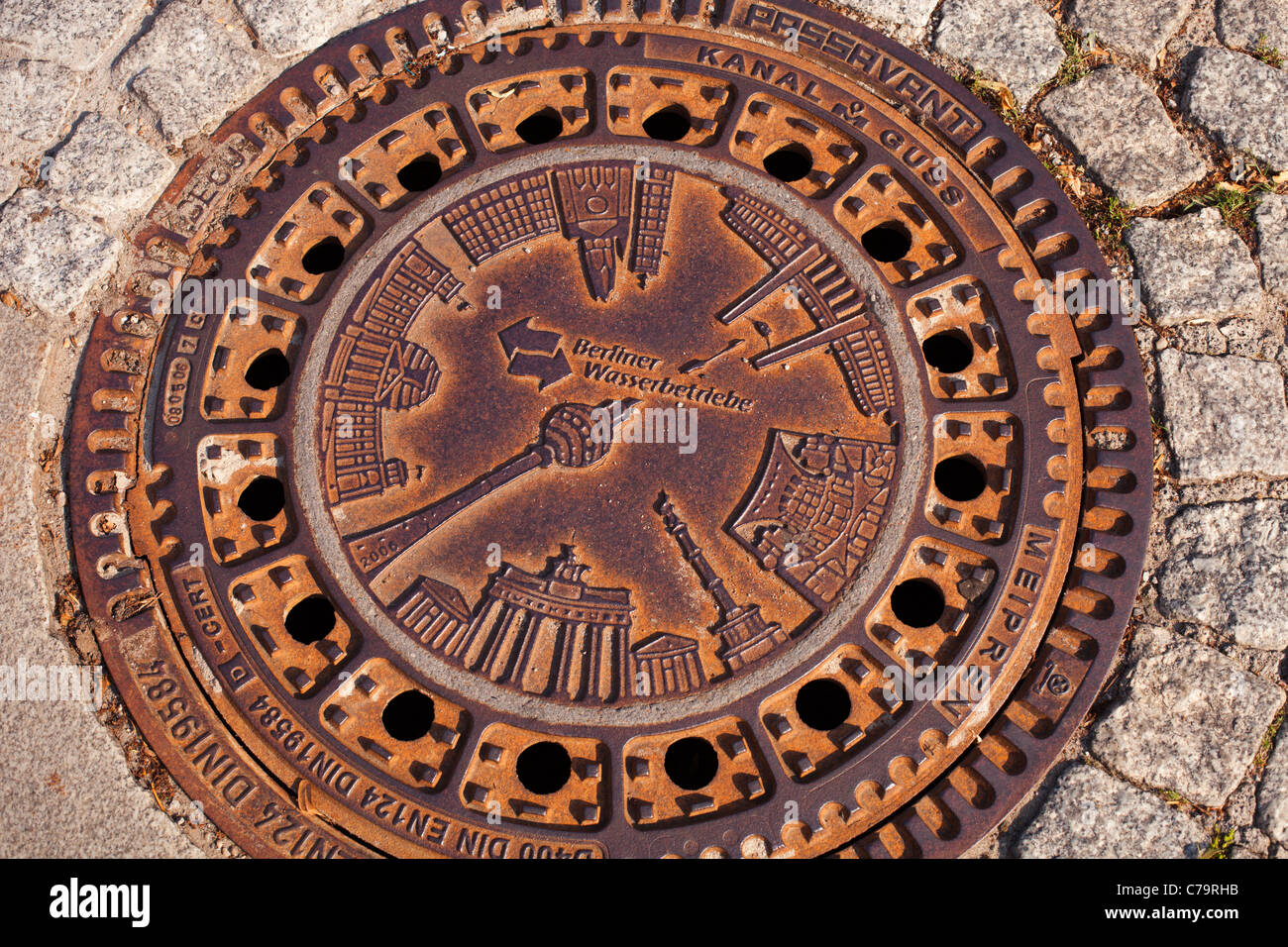 Manhole cover in Berlin, Germany. - Stock Image