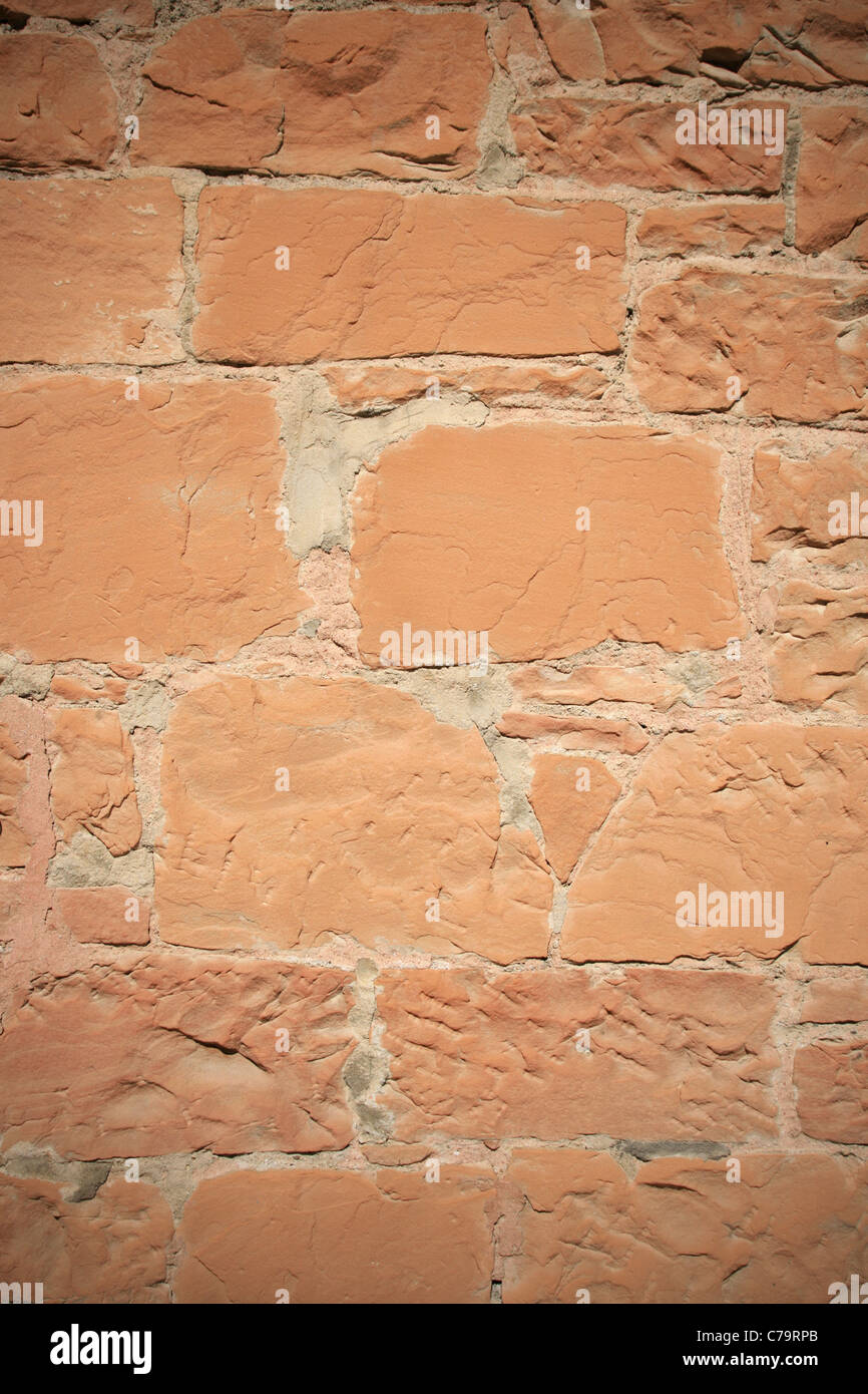 vignetted vertical old red sandstone wall - Stock Image