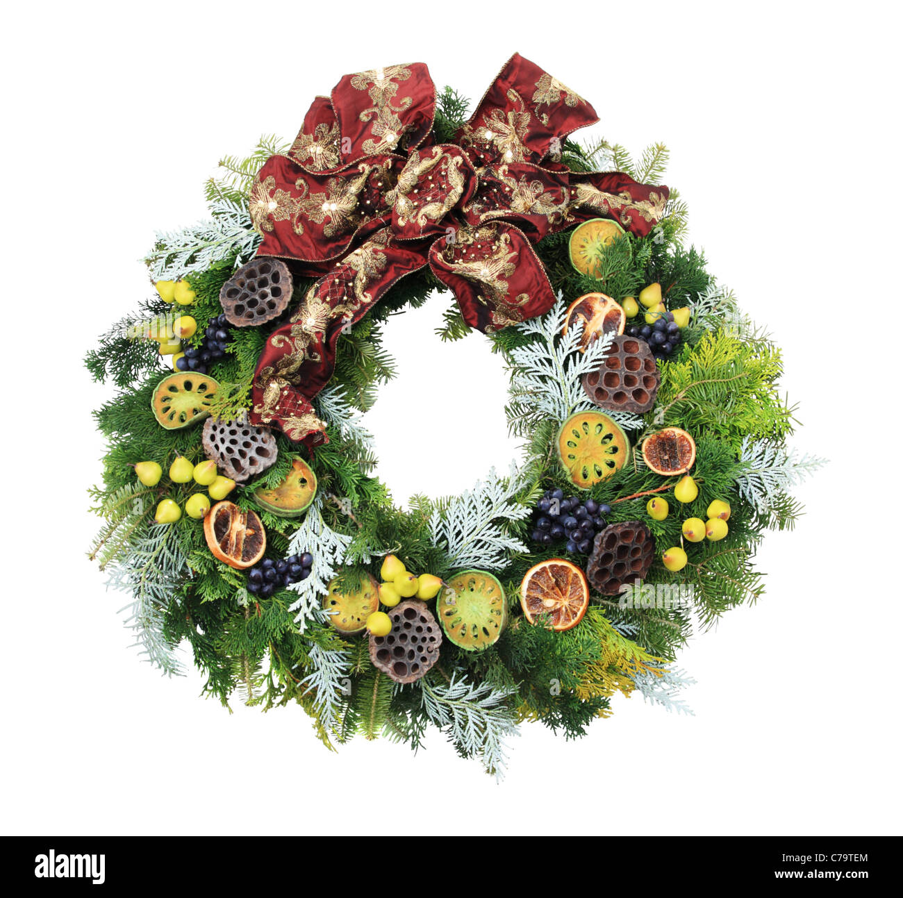 christmas wreath with mini pears and other decorations and a red bow isolated on white - Stock Image
