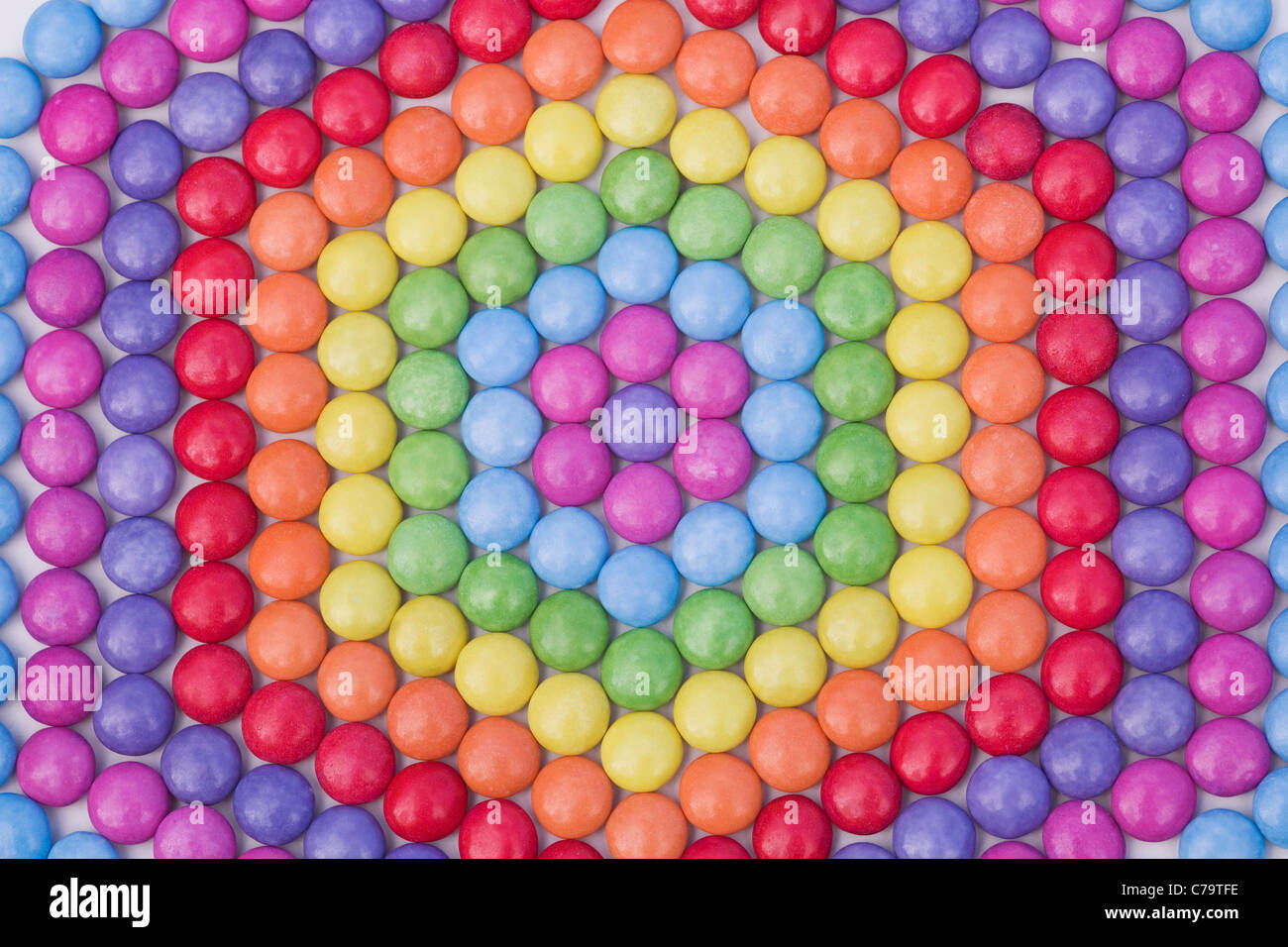 Hexagon shaped smartie pattern. Close up - Stock Image