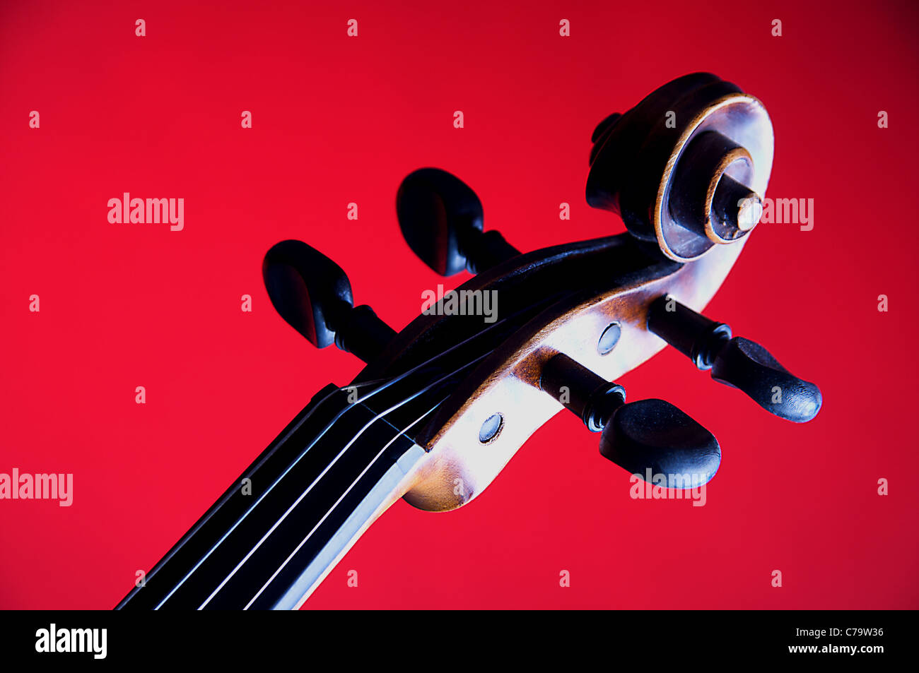 Violin Viola Scroll Isolated on Red - Stock Image