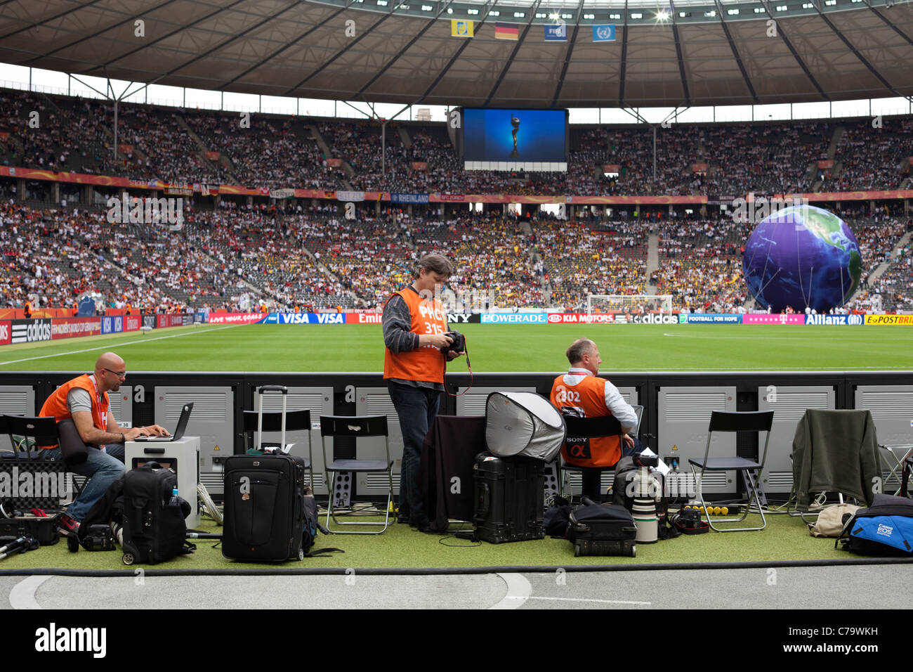 Photographers in shooting positions at Berlin's Olympic Stadium ahead of the opening match of the 2011 Women's - Stock Image