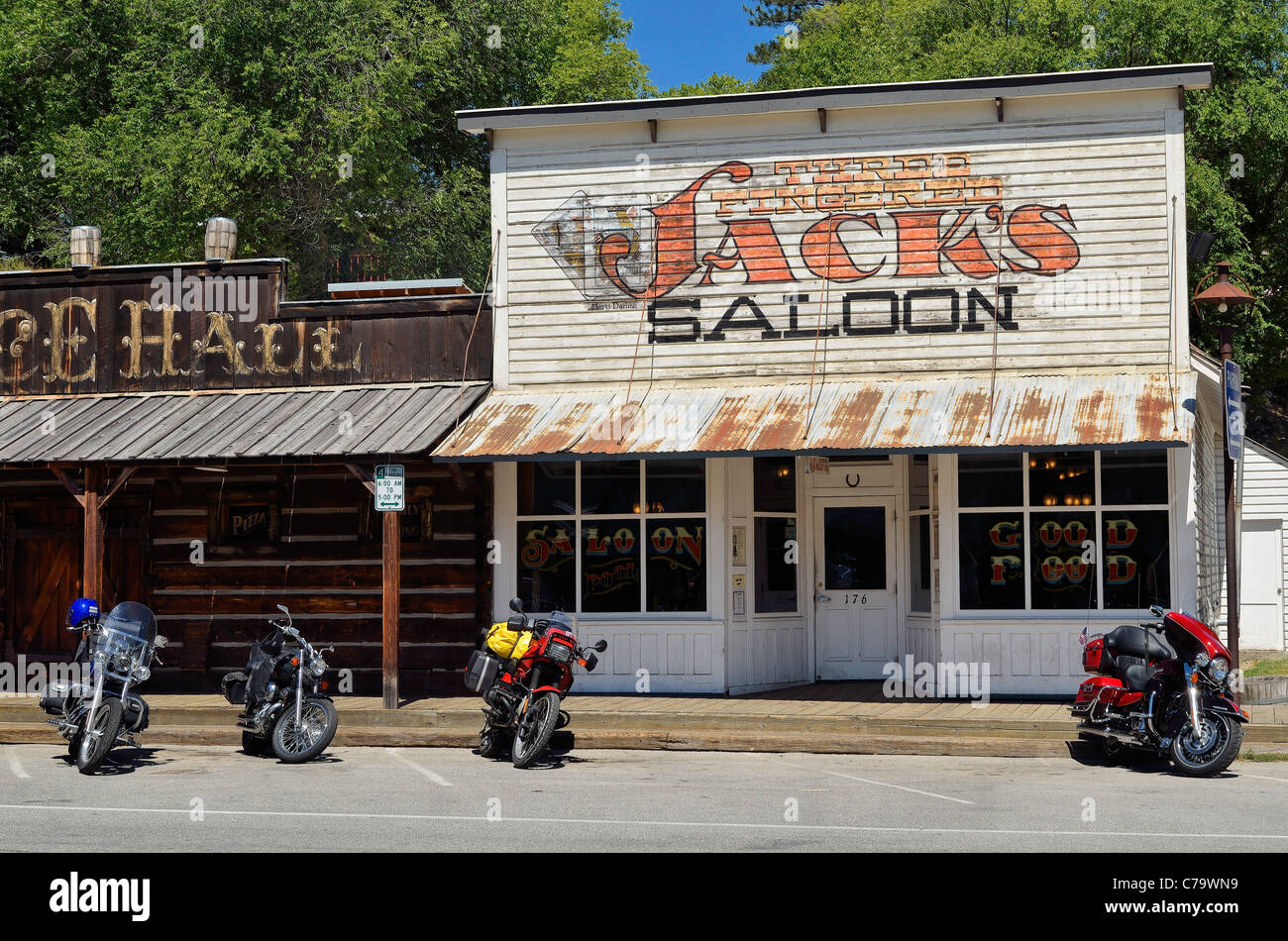 Motorcycles outside Three Fingered Jack's Saloon, Winthrop, Washington, USA - Stock Image