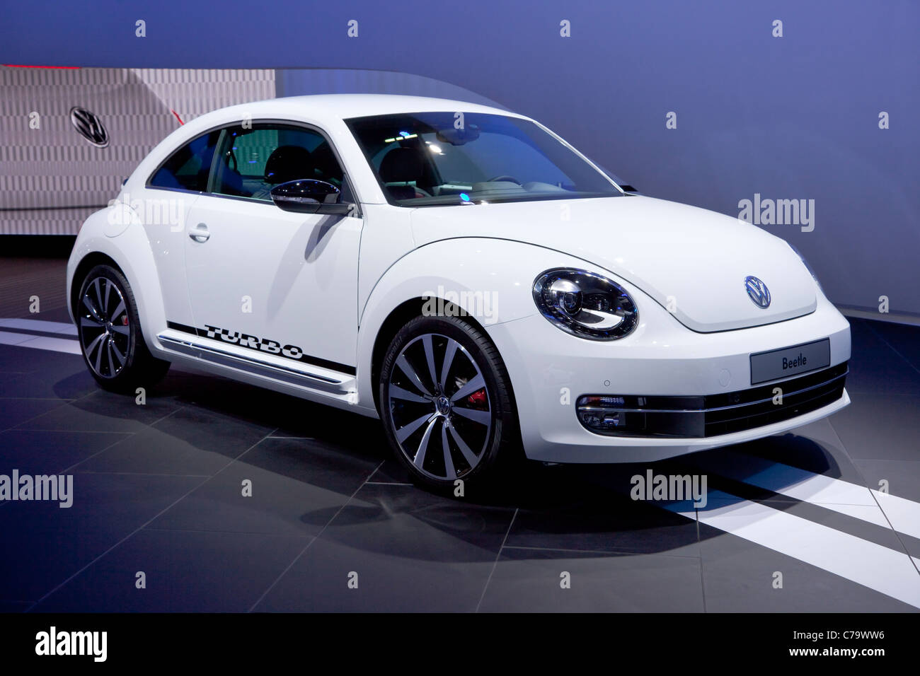 New VW Volkswagen Beetle turbo on the IAA 2011 International Motor Show in Frankfurt am Main, Germany - Stock Image