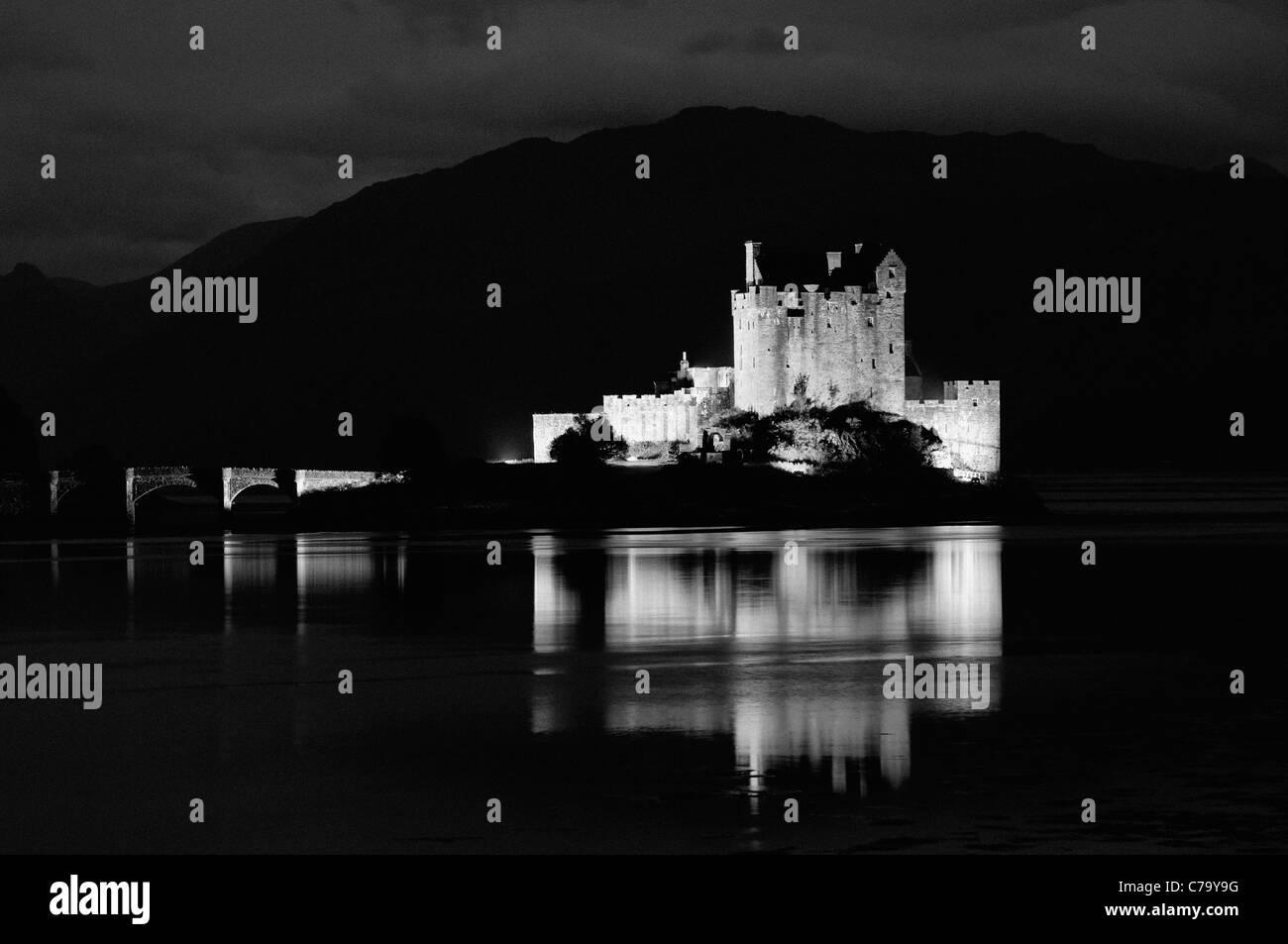 Black and White Photo of Eilean Donan Castle on Loch Duich at Twilight - Near Dornie, Scotland - Stock Image