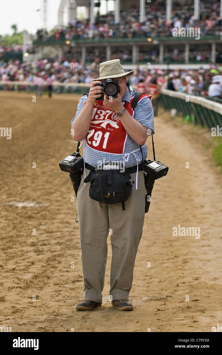 Professional Photographer Jonathan Roberts Shooting Photos on the Track at Churchill Downs in Louisville, Kentucky - Stock Image