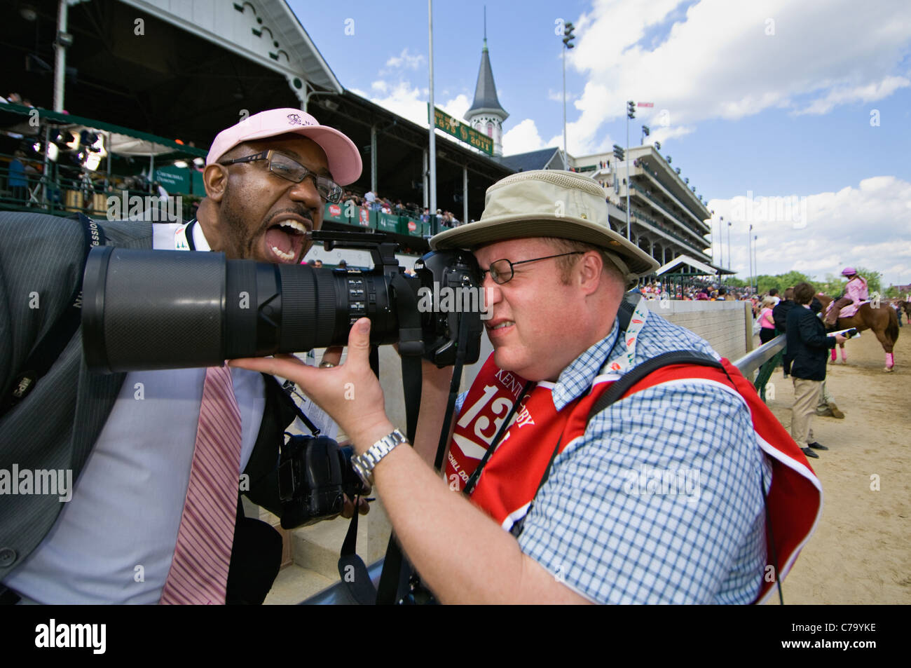 Photographer Jonathan Roberts Shooting Photos on Track at Churchill Downs as Marvin Young Jokes Around in Louisville, - Stock Image