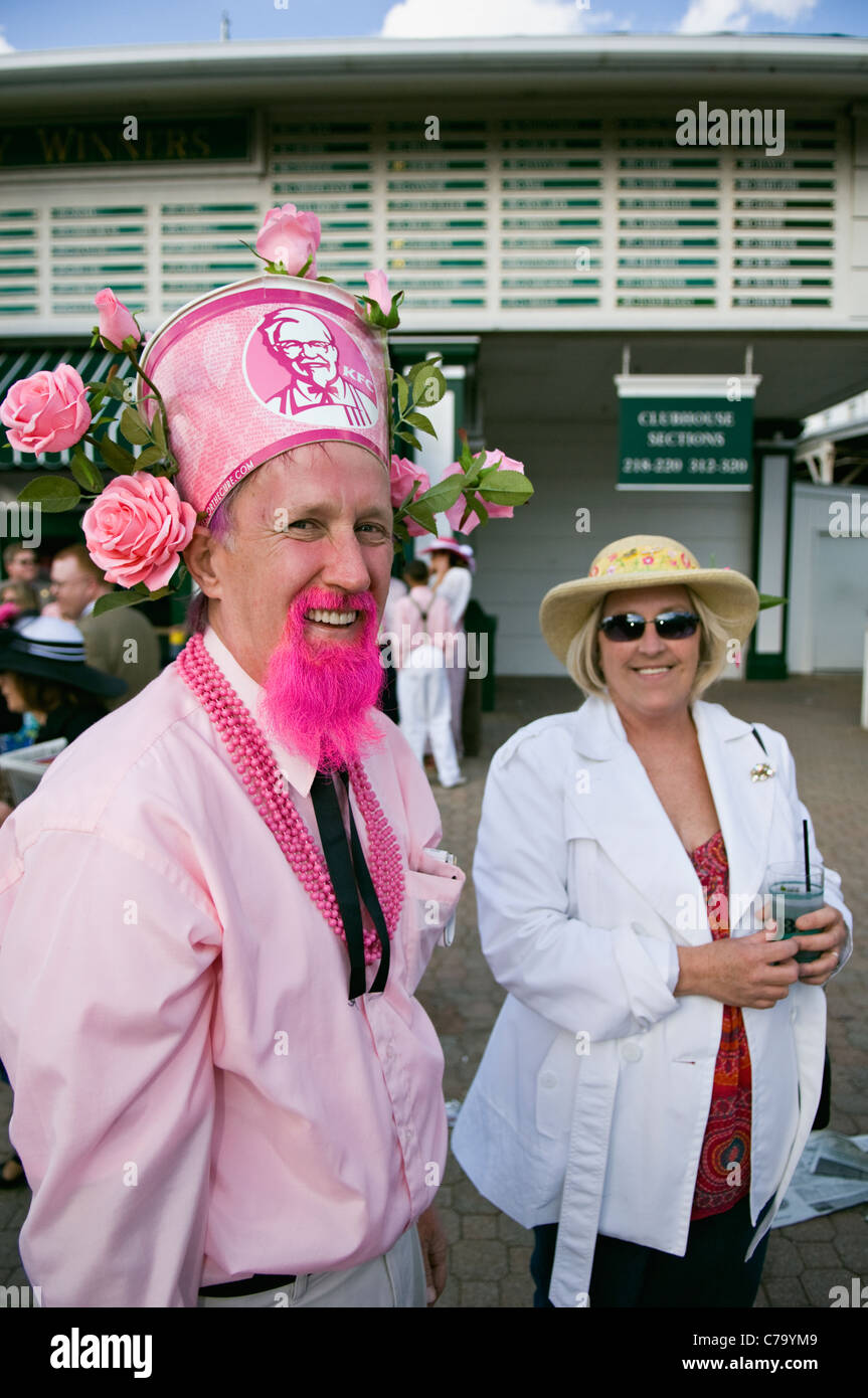 Man in Funny Hat and Pink Goatee at Churchill Downs on Oaks Day in Louisville, Kentucky - Stock Image