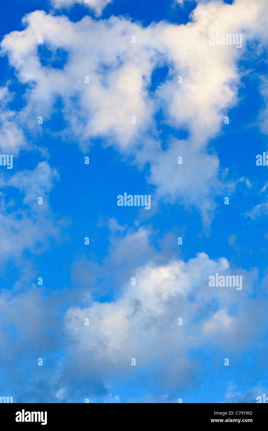 White Cumulus Clouds in a Blue Sky - Stock Image